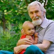 Grandfather and granddaughter — Stock Photo #1607814