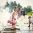 Girl and fountain — Stock Photo #1607815