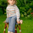 Girl sits on stool — Stock Photo