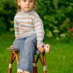 Girl sits on stool — Stock Photo