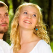 Royalty-Free Stock Photo: Portrait of man and woman in park.