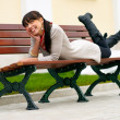 Beautiful girl lays on bench — Stock Photo #1607991