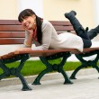 Royalty-Free Stock Photo: Beautiful girl lays on bench