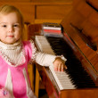 Young girl about piano — Stock Photo