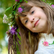 Girl with wreath smiles — Stock Photo