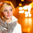 Blonde against night city — Stock Photo