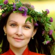 Woman with wreath on head - Stock Photo