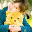 Little girl with teddy bear — Stock Photo #1609133