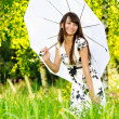 Girl under sun-protection umbrella — Stock Photo #1609141