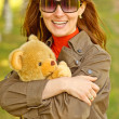 Girl with teddy bear — Stock Photo #1609147