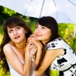 Two girls and an umbrella - Stock Photo