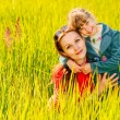 Mother and daughter on a meadow — Stock Photo