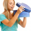 Royalty-Free Stock Photo: Blonde takes out gift