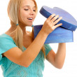 Blonde takes out gift — Stock Photo