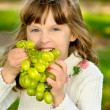 Young girl with grapes — Stock Photo
