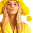 Royalty-Free Stock Photo: Portrait of blonde in yellow fur cap