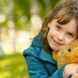 Child with toy bear cub - Stock Photo