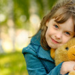 Child with toy bear cub - Photo