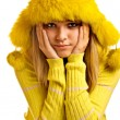 Portrait of blonde in yellow fur cap — Stock Photo