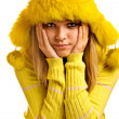 Portrait of blonde in yellow fur cap - Stock Photo