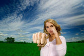Girl beats a fist — Stock Photo