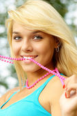 Blonde with beads — Stock Photo