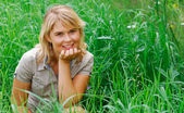 Girl in a grass — Stock Photo