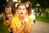 Two girls in yellow dresses — Stock Photo