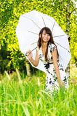 Girl under sun-protection umbrella — Stock Photo
