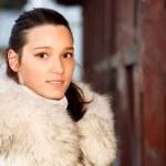 Portrait of girl in white fur coat — Stock Photo #1610777