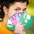 Girl with diskettes — Stock Photo #1610787