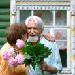 Pensioners with florets — Stock Photo