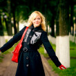 Blonde on footpath in park — Stock Photo