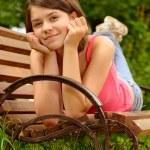 Постер, плакат: Girl lays on bench