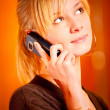 Blonde speaks by mobile phone — Stock Photo #1611839