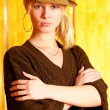 Blonde in checkered hat — Stock Photo