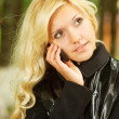 Blonde with mobile phone — Stock Photo