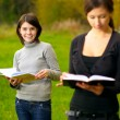 Girl-friends behind lessons — Stock Photo