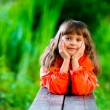 Stock Photo: Girl on bench