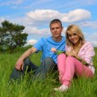 Young man and girl on a meadow — Stock Photo