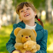 Child with toy bear cub — Stock Photo