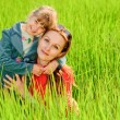 Stock Photo: Mother and daughter on meadow