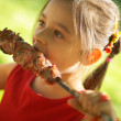 The girl eats a kebab — Stock Photo