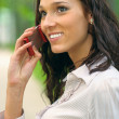 Brunette speaks on cellular telephone — Stock Photo