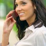 Brunette speaks on cellular telephone — Stock Photo