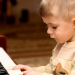Boy plays piano — Stock Photo #1613514