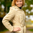 Girl in light jacket laughs — Stock Photo