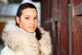 Portrait of girl in white fur coat — Stock Photo