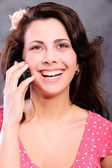 Woman speaks by mobile phone — Stock Photo