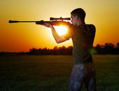 Sniper for a sunset. — Stockfoto